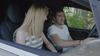 Young Man with Young Girl Using Sensory Dashboard Inside the Modern Auto