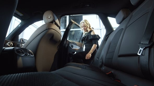 Thumbnail for Woman Exploring Car in Salon