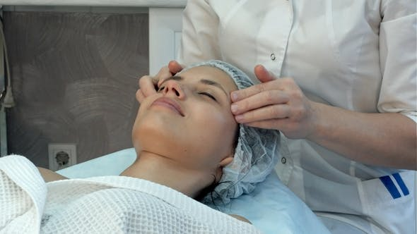 Thumbnail for Young Masseuse Giving an Attractive Woman Neck and Shoulders Massage at Beauty Spa