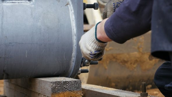 Thumbnail for Employee Unfixes Fasteners on Metal Construction