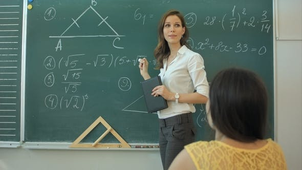 Thumbnail for Clever Confident Female Student in the Classroom Writing on a Chalkboard Math