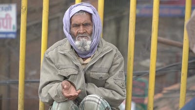 Beggar Begs for Money