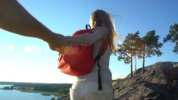 Thumbnail for Young Woman Leading a Man To Climb High Wild Cliff