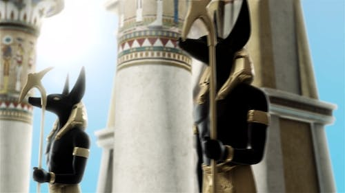 Statues of Anubis Near the Egyptian Columns