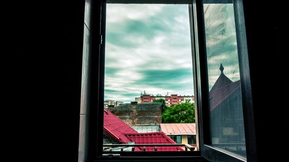 Thumbnail for of Moving Dark Clouds Over the City Through a Window