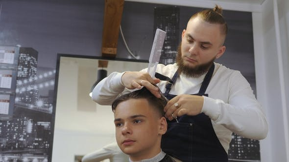 Thumbnail for Hairdresser for Men. Barbershop. Caring for the Beard. Barber with Hair Clipper Works on Hairstyle