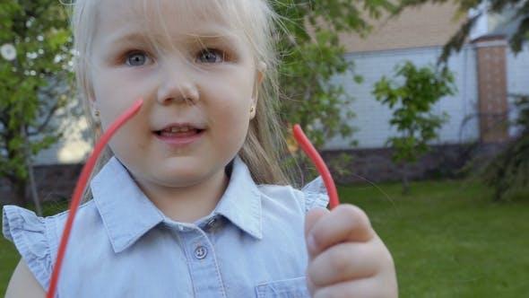 Thumbnail for Funny Little Girl Put on Her Face Adult Eyeglasses