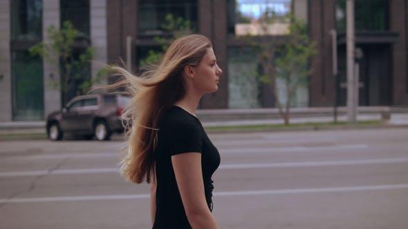 Elegant Businesswoman Walks on Street