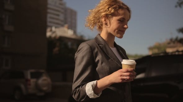 Attractive Woman Holding To Go Coffee