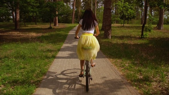 Thumbnail for Female Cycling on Bicycle Sunlight