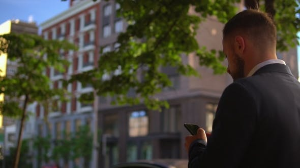 Thumbnail for Entrepreneur Checking Email on Smartphone in City