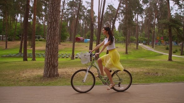 Thumbnail for Girl Cycling on Bike Summertime
