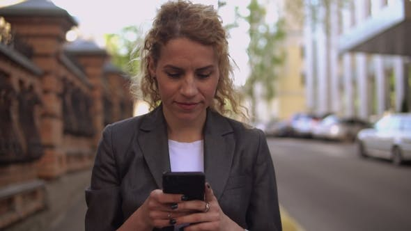 Thumbnail for Young Woman Checking Email on the Run