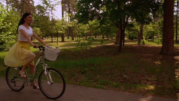 Thumbnail for Happy Girl Cycling on Bicycle Sunlight