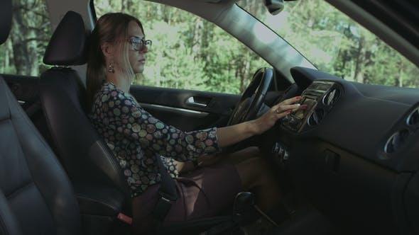 Thumbnail for Pretty Female Driver Using GPS Navigator in Car