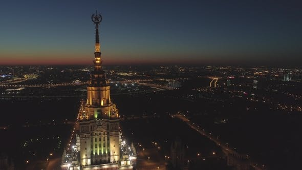 Thumbnail for Illuminated Moscow State University and Cityscape in Morning Twilight. Russia. Aerial View