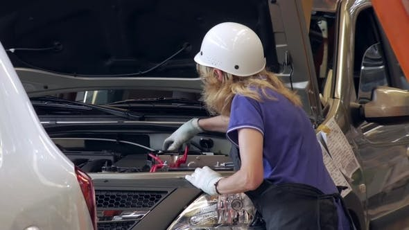 Thumbnail for Worker Woman Is Tightening Caps of Capacities for Technical Liquids Inside a Car on a Car Factory