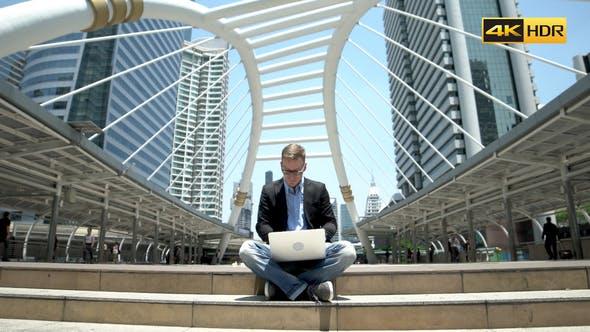 Thumbnail for Developer Working On Laptop At Street