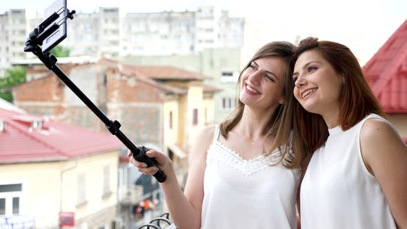 Thumbnail for Two Best Friends Smiling and Laughing While Taking a Selfie
