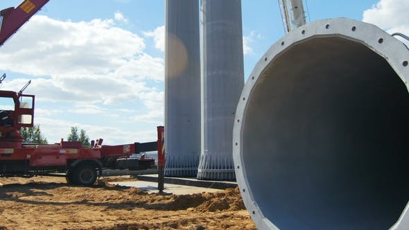 Thumbnail for Worker Controls Pipe Shape Tower Installation with Car Cranes
