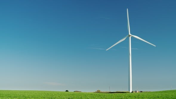 Cover Image for Idyllicistic Landscape of a Green Meadow and a Wind Generator. Ecology and Environment Concept.  1