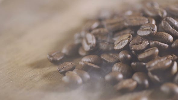 Thumbnail for Coffee Beans Are Loaded Into the Espresso Machine for Grinding