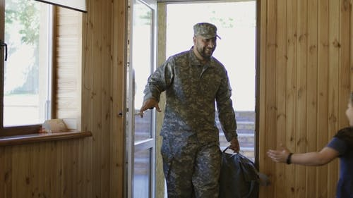 Soldier Entering Home with Happy Family