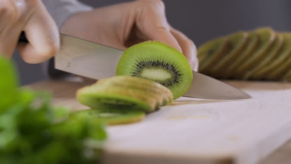 Thumbnail for Hand Slicing a Kiwi with a Knife
