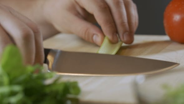 Thumbnail for Chef Cook Professionally Cutts Celery on Cutting Board