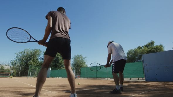 Thumbnail for Trainer with Man Learning Racket Shots