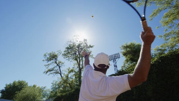 Cover Image for Man Showing Tennis Serving in Sunlight