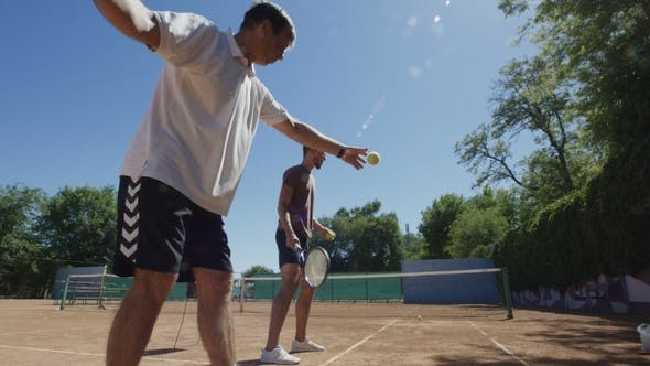 Thumbnail for Men Playing Tennis Against Wall