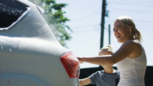 Thumbnail for Woman with Children Washing Car
