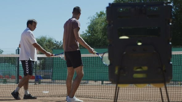 Thumbnail for Tennis Trainer Working with Man on Court