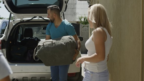 Thumbnail for Cheerful Family Loading Car with Bags Before Vacation