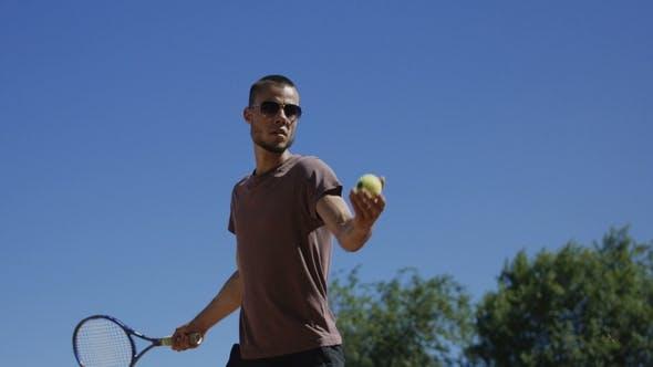 Thumbnail for Man Training Forehand Shot in Sunlight