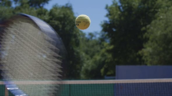 Thumbnail for Tennis Ball Flying Over Net