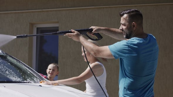Thumbnail for Happy Family Washing Car Together