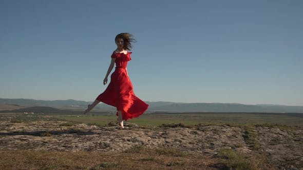 Thumbnail for Model in a Fluttering in the Wind Dress Against the Background of the Horizon