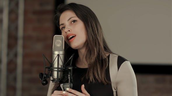 The Girl Sings at Restaurant
