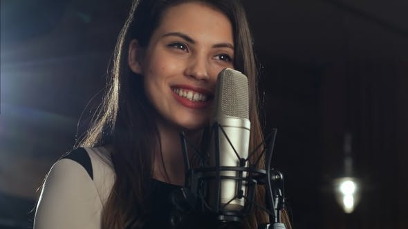 Thumbnail for Singer Standing in Front of a Microphone and Singing