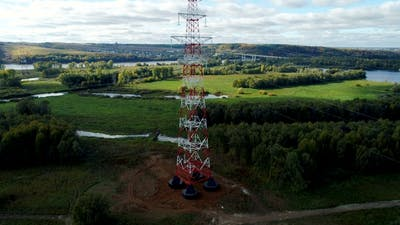 Tension Tower with Phase Transposition of Power Line Against Landscape