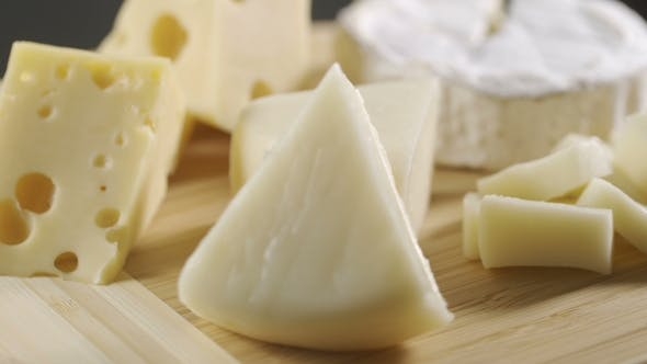Thumbnail for Pieces of Different Cheeses on Plate