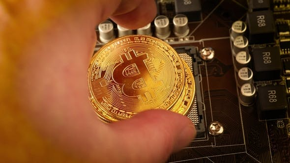 Thumbnail for Gold Bit Coin BTC Coins on the Motherboard. Bitcoin Is a Worldwide Cryptocurrency
