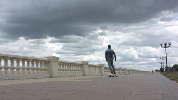 Thumbnail for Man Riding a Skateboard and Loosing Balance