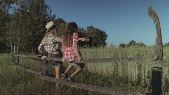 Thumbnail for Mother and Daughter Resting in Nature at Sunset