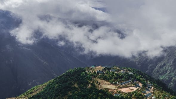 Thumbnail for The Movement of Clouds Over the Valley and Mountain Village in the Himalayas