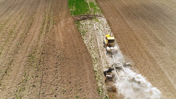 Aerial Footage of a Tractor on a Field