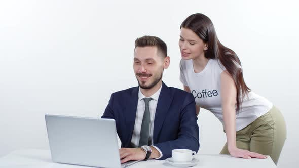 Thumbnail for Woman Talking to Businessman Working on Laptop