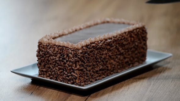 Thumbnail for Cutting Chocolate Cake on Table